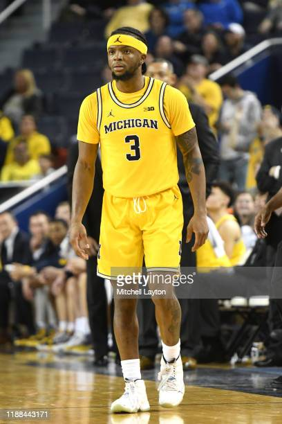 Zavier Simpson of the Michigan Wolverines looks on during a basketball game against the Creighton Bluejays at the Crisler Center on November 12, 2019...