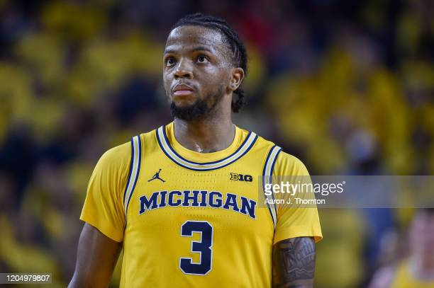 Zavier Simpson of the Michigan Wolverines looks on during the second half of a college basketball game against the Ohio State Buckeyes at Crisler...