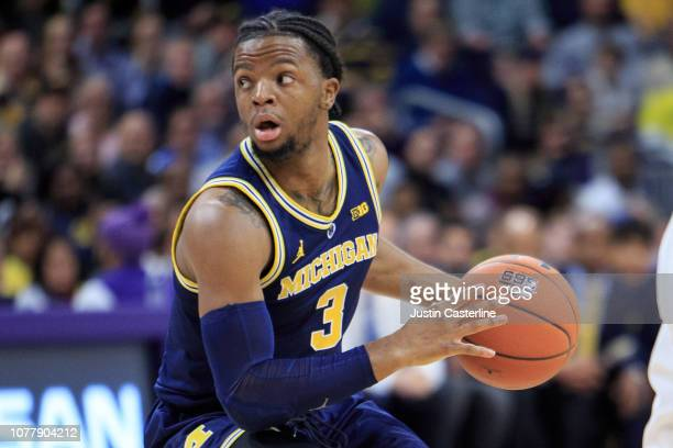 Zavier Simpson of the Michigan Wolverines looks to pass the ball in the game against the Northwestern Wildcats in the first half at WelshRyan Arena...