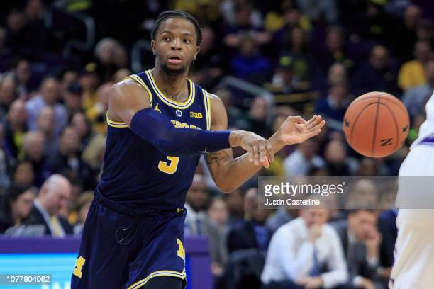 Zavier Simpson of the Michigan Wolverines passes the ball in the game against the Northwestern Wildcats in the first half at WelshRyan Arena on...