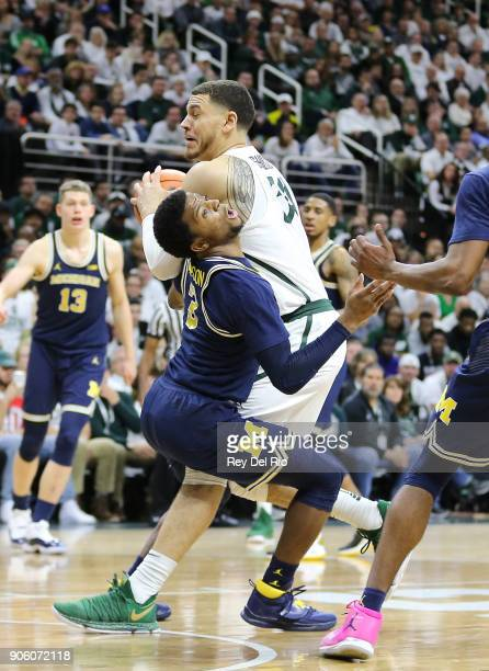 Zavier Simpson of the Michigan Wolverines picks up a charging foul on Gavin Schilling of the Michigan State Spartans at Breslin Center on January 13...