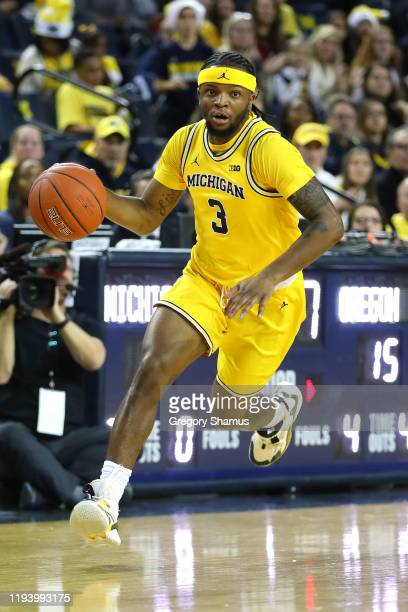 Zavier Simpson of the Michigan Wolverines plays against the Oregon Ducks at Crisler Arena on December 14, 2019 in Ann Arbor, Michigan. Oregon won the...