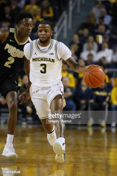 Zavier Simpson of the Michigan Wolverines plays against the Purdue Boilermakers at Crisler Arena on January 09, 2020 in Ann Arbor, Michigan.