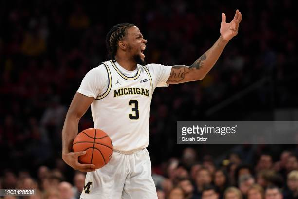 Zavier Simpson of the Michigan Wolverines reacts after a call during the first half against the Rutgers Scarlet Knights at Madison Square Garden on...