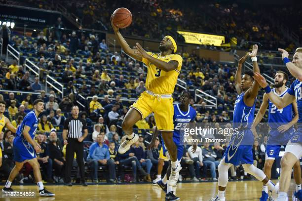 Zavier Simpson of the Michigan Wolverines scores a basket during the first half of a college basketball game against the Creighton Bluejays at...