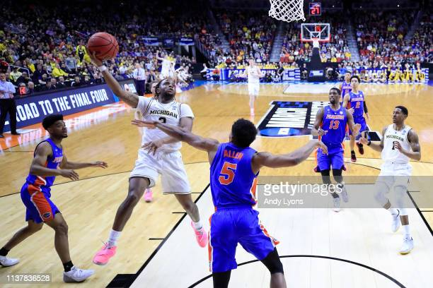 Zavier Simpson of the Michigan Wolverines shoots the ball against the Florida Gators during the first half in the second round game of the 2019 NCAA...