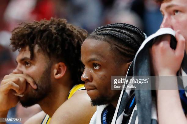 Zavier Simpson of the Michigan Wolverines shows his frustration on the bench during the 2019 NCAA Men's Basketball Tournament West Regional game...
