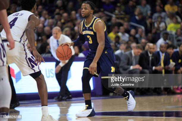 Zavier Simpson of the Northwestern Wildcats brings the ball up the court in the game against the Northwestern Wildcats in the first half at WelshRyan...