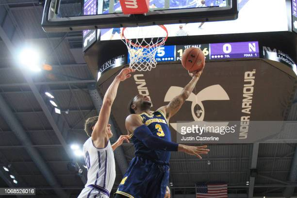 Zavier Simpson of the Northwestern Wildcats drives to the basket during the first half in the game against the Northwestern Wildcats at WelshRyan...