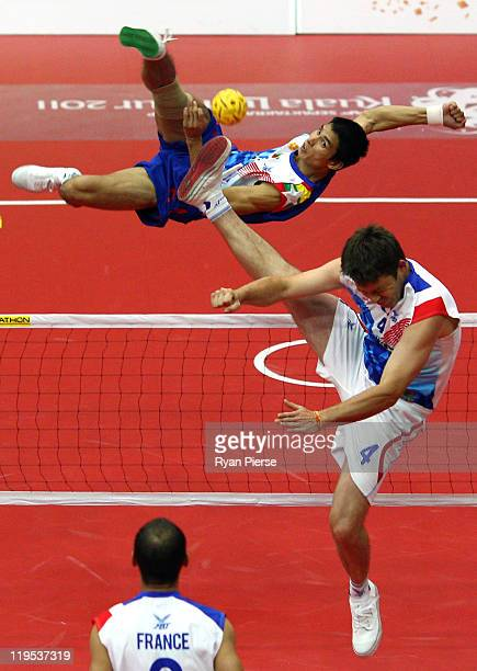 Zaw Lat of Myanmar kicks over the net against Mathieu Fleutlet of France during the Round Robin match between Myanmar and France day two of the ISTAF...