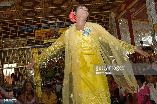 Zaw Moe a medium dances in a shrine dedicated to the nats during the Taungbyon festival Every year in August hundreds of thousands of people from all...