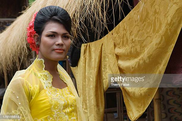 Zaw Moe, a medium, in a ceremonial dress before a dance at Taungbyon festival. Every year in August, hundreds of thousands of people from all over...