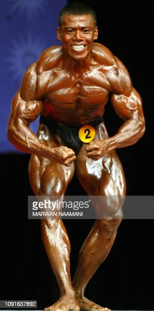 Zaw Oo Min of Myanmar winner of the bronze medal in bodybuilding for men's 75kgs category shows his muscles to the jury at Busan City Hall 06 October...
