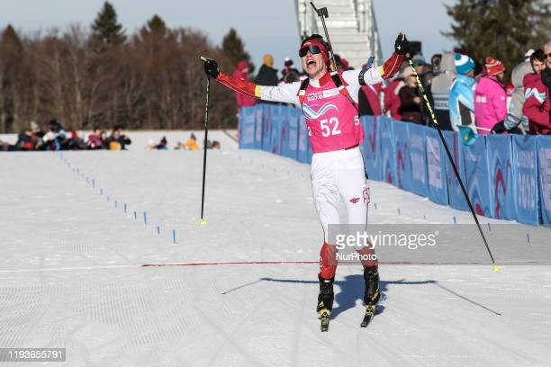 Zawol Marcin from Poland cheers at the finish line after winning Biathlon race Men's 75km Sprint during 5 day of Winter Youth Olympic Games Lausanne...