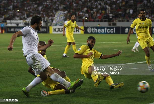 Zawraa's defender Hussein Jwayed passes the ball during the AFC champions league Group A football match between Iraq's Al Zawraa and UAE's Al Wasl at...
