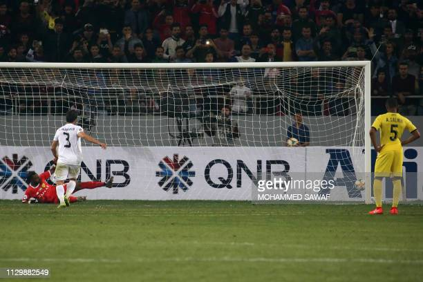 Zawraa's defender Hussein Jwayed scores a penalty during the AFC champions league Group A football match between Iraq's Al Zawraa and UAE's Al Wasl...