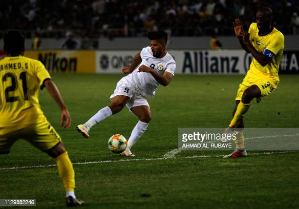 Zawraa's forward Alaa Abbas attempts a shot as he is closed down by Wasl's defender Abdullah AlJunaibi during the AFC champions league Group A...