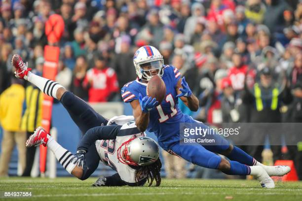 Zay Jones of the Buffalo Bills attempts to catch the ball as Stephon Gilmore of the New England Patriots attempts to defend him during the fourth...