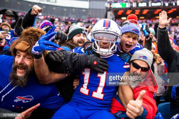 Zay Jones of the Buffalo Bills celebrates a touchdown reception with fans during the first quarter against the Miami Dolphins at New Era Field on...