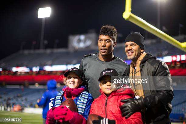 Zay Jones of the Buffalo Bills poses for a photo with hall of famer Andre Reed before the game against the New England Patriots at New Era Field on...