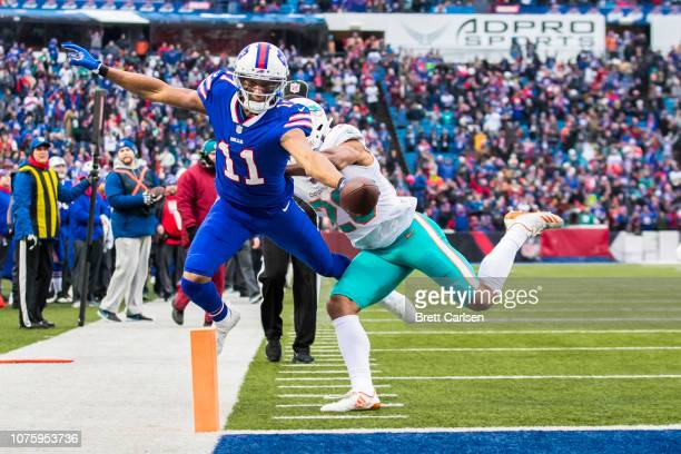 Zay Jones of the Buffalo Bills stretches for a touchdown during the first quarter as Minkah Fitzpatrick of the Miami Dolphins defends at New Era...