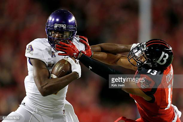 Zay Jones of the East Carolina Pirates stiffarms Grant Coleman of the Cincinnati Bearcats while carrying the ball during the first quarter at Nippert...