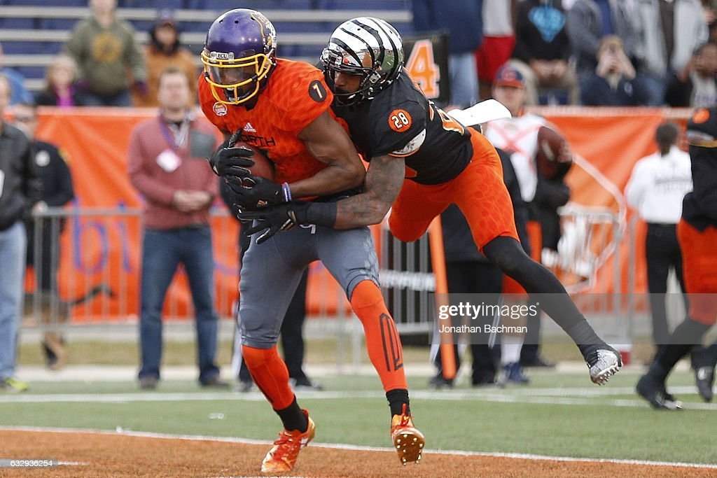 Zay Jones #7 of the North team catches the ball as Maulet Arthur #28 of the South team defends during the second half of the Reese's Senior Bowl at the Ladd-Peebles Stadium on January 28, 2017 in Mobile, Alabama.
