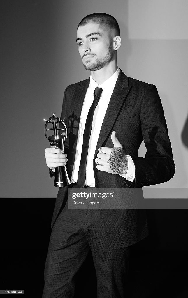 Image has been converted to black and white.) Zayn Malik accepts his award for Outstanding Achievement in Music during The Asian Awards 2015 at The Grosvenor House Hotel on April 17, 2015 in London, England.