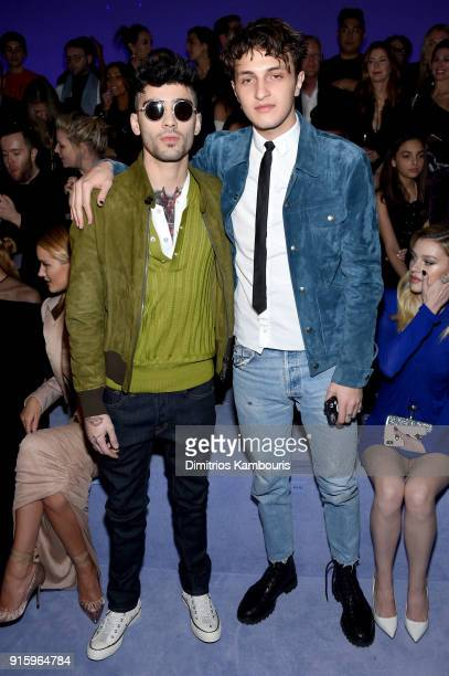 Zayn Malik and Anwar Hadid attend the Tom Ford Fall/Winter 2018 Women's Runway Show at the Park Avenue Armory on February 8 2018 in New York City