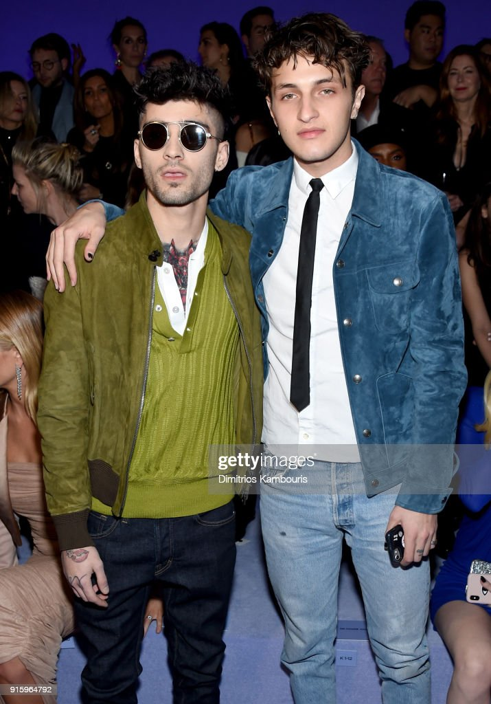 Zayn Malik and Anwar Hadid attend the Tom Ford Fall/Winter 2018 Women's Runway Show at the Park Avenue Armory on February 8, 2018 in New York City.