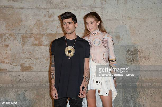 Zayn Malik and Gigi Hadid attend the Givenchy show as part of the Paris Fashion Week Womenswear Spring/Summer 2017on October 2 2016 in Paris France