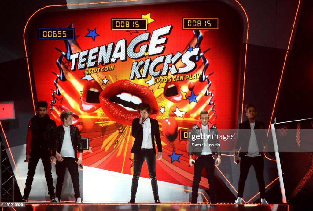 Zayn Malik, Niall Horan, Harry Styles, Liam Payne and Louis Tomlinson of One Direction perform on stage during the Brit Awards 2013 at 02 Arena on February 20, 2013 in London, England.