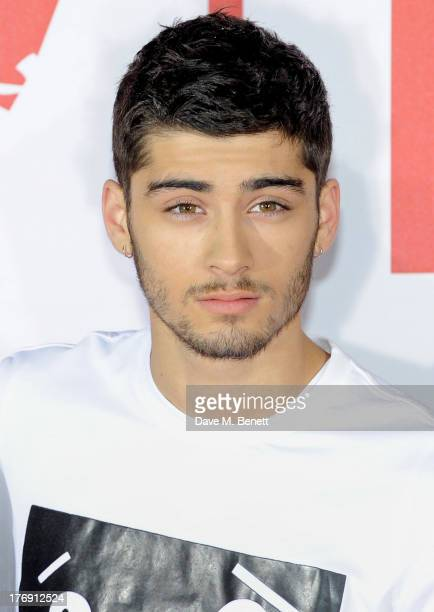 Zayn Malik of One Direction attends a photocall to launch their new film 'One Direction: This Is Us 3D' at Big Sky Studios on August 19, 2013 in...