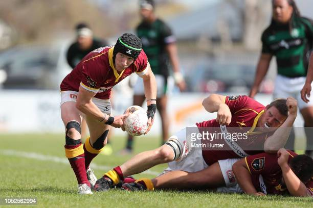 Zayn Tipping of King Country passes the ball from a ruck during the Heartland Championship Meads Cup Semi Final match between South Canterbury and...