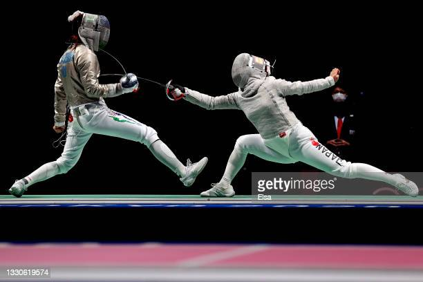 Zaynab Dayibekova of Team Uzbekistan, left, competes against Chika Aoki of Team Japan Women's Sabre Individual first round on day three of the Tokyo...