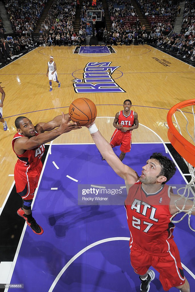 Zaza Pachulia #27 and Al Horford #15 of the Atlanta Hawks go after the rebound in a game against the Sacramento Kings on November 16, 2012 at Sleep Train Arena in Sacramento, California.