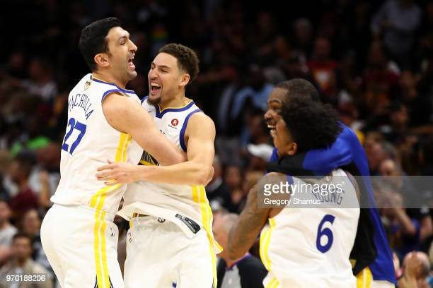 Zaza Pachulia and Andre Iguodala of the Golden State Warriors celebrate after defeating the Cleveland Cavaliers during Game Four of the 2018 NBA...