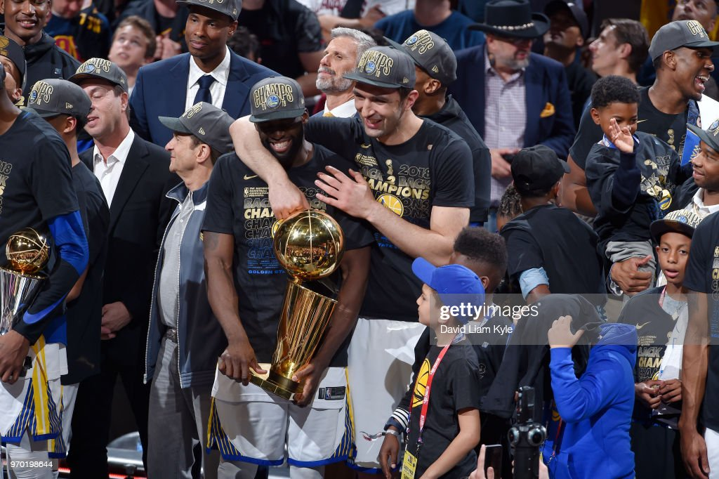OH - Zaza Pachulia #27 and Draymond Green #23 of the Golden State Warriors celebrate as they hold the Larry O'Brien NBA Championship Trophy after Game Four of the 2018 NBA Finals on June 8, 2018 at Quicken Loans Arena in Cleveland, Ohio.