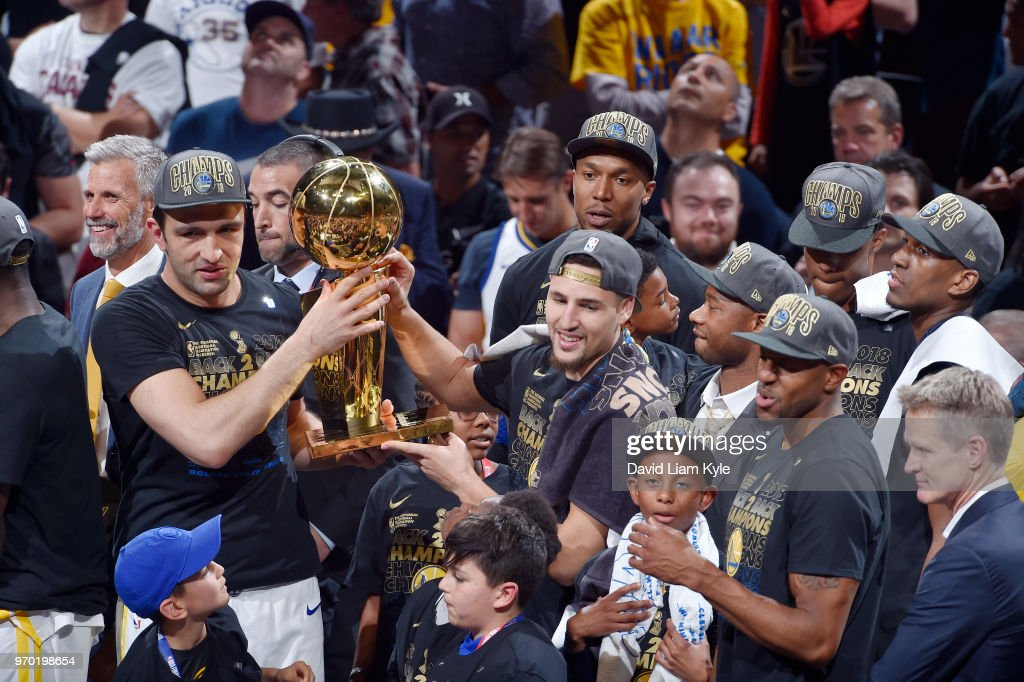 OH - Zaza Pachulia #27 and Klay Thompson #11 of the Golden State Warriors celebrate as they hold the Larry O'Brien NBA Championship Trophy after Game Four of the 2018 NBA Finals on June 8, 2018 at Quicken Loans Arena in Cleveland, Ohio.