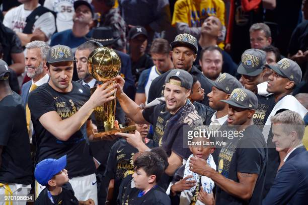 OH Zaza Pachulia and Klay Thompson of the Golden State Warriors celebrate as they hold the Larry O'Brien NBA Championship Trophy after Game Four of...