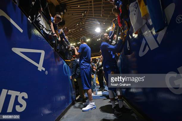 Zaza Pachulia and Stephen Curry of the Golden State Warriors sign autographs for fans prior to the game against the Sacramento Kings on March 16 2018...