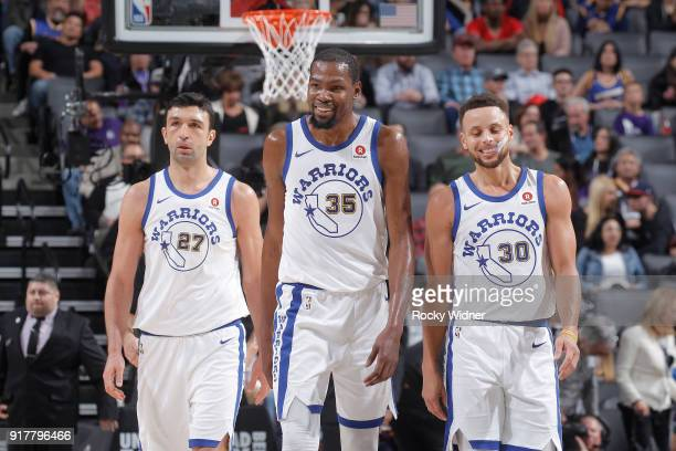 Zaza Pachulia Kevin Durant and Stephen Curry of the Golden State Warriors face the Sacramento Kings on February 2 2018 at Golden 1 Center in...