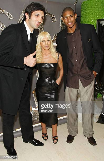 Zaza Pachulia of the Atlanta Hawks designer Donatella Versace and Al Horford of the Atlanta Hawks inside the Versace Menswear Launch at Barneys New...