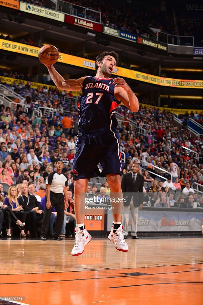 Zaza Pachulia #27 of the Atlanta Hawks grabs a rebound against the Phoenix Suns on March 1, 2013 at U.S. Airways Center in Phoenix, Arizona.