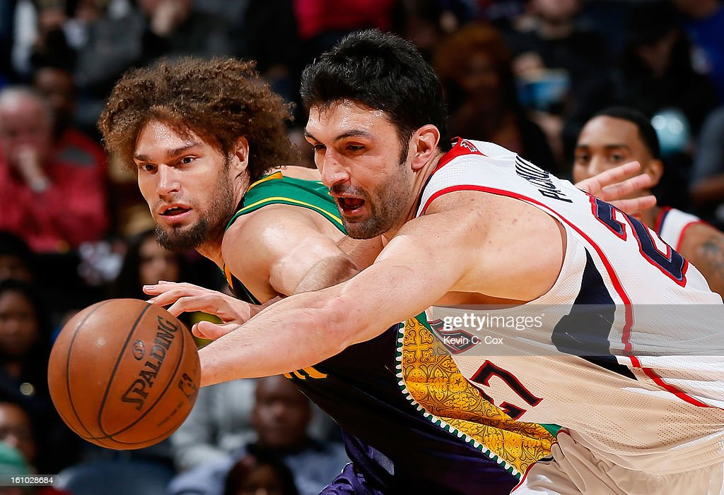 Zaza Pachulia #27 of the Atlanta Hawks steals the ball from Robin Lopez #15 of the New Orleans Hornets at Philips Arena on February 8, 2013 in Atlanta, Georgia.