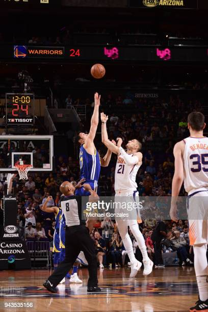 Zaza Pachulia of the Golden State Warriors and Alex Len of the Phoenix Suns tip off at the start of the game between the two teams on April 8 2018 at...