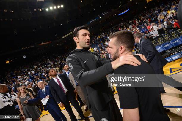 Zaza Pachulia of the Golden State Warriors and JJ Barea of the Dallas Mavericks after the game on February 8 2018 at ORACLE Arena in Oakland...