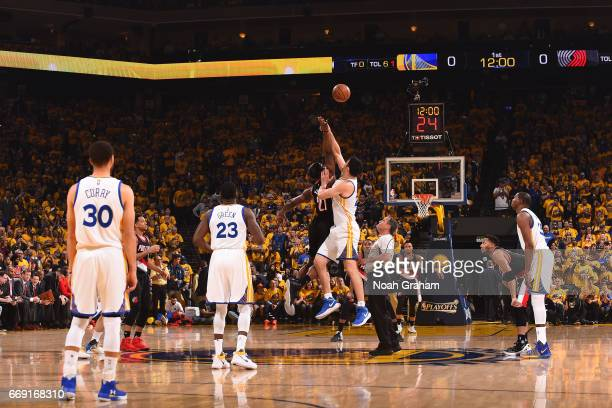 Zaza Pachulia of the Golden State Warriors and Noah Vonleh of the Portland Trail Blazers jump for possession of the ball during the Western...
