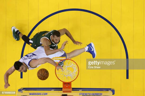 Zaza Pachulia of the Golden State Warriors and Rudy Gobert of the Utah Jazz go for the ball during Game One of the Western Conference Semifinals of...