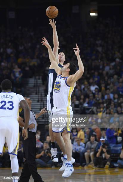Zaza Pachulia of the Golden State Warriors battles for the tipoff with Mason Plumlee of the Denver Nuggets during an NBA Basketballl game at ORACLE...